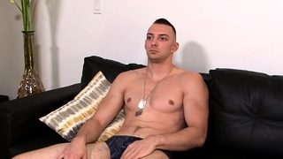Muscly soldier tugs dick